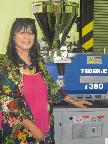Isabelle Bretteny Plastics SA's Regional Training Manager (Western Cape) proudly showing off the the new Tederic 1380 Injection Moulding Machine