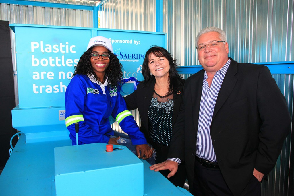RECYCLING REWARDS: Ermelo recycling entrepreneur Johanna Leshabane (left) has received a significant hand-up, thanks to R500,000 worth of supporting infrastructure from the PET Recycling Company (PETCO) and polymer producer Safripol. Here PETCO's Belinda Booker (centre) and KAP Chemicals (Safripol) chief executive officer Leigh Pollard hand over her new equipment. (Image: supplied)